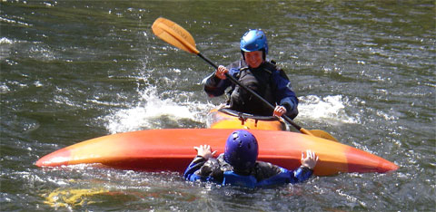 Canoe safety: A kayaker comes to the rescue of another kayaker who has fallen into the water